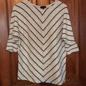 White knit top with blue lines